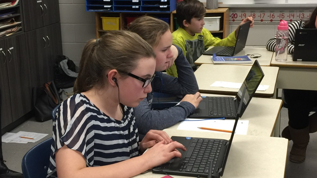 St Luke Grade 7 students Indiana Coffin, Genevieve Dunn and Myles Collins take part in the Hour of Code